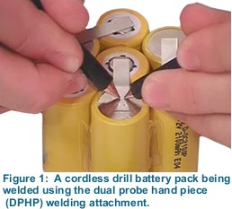 Figure 1:  A cordless drill battery pack being welded using the dual probe hand piece (DPHP) welding attachment.