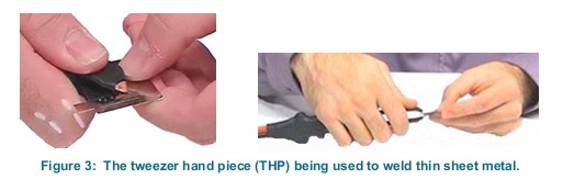Figure 3:  The tweezer hand piece (THP) being used to weld thin sheet metal.